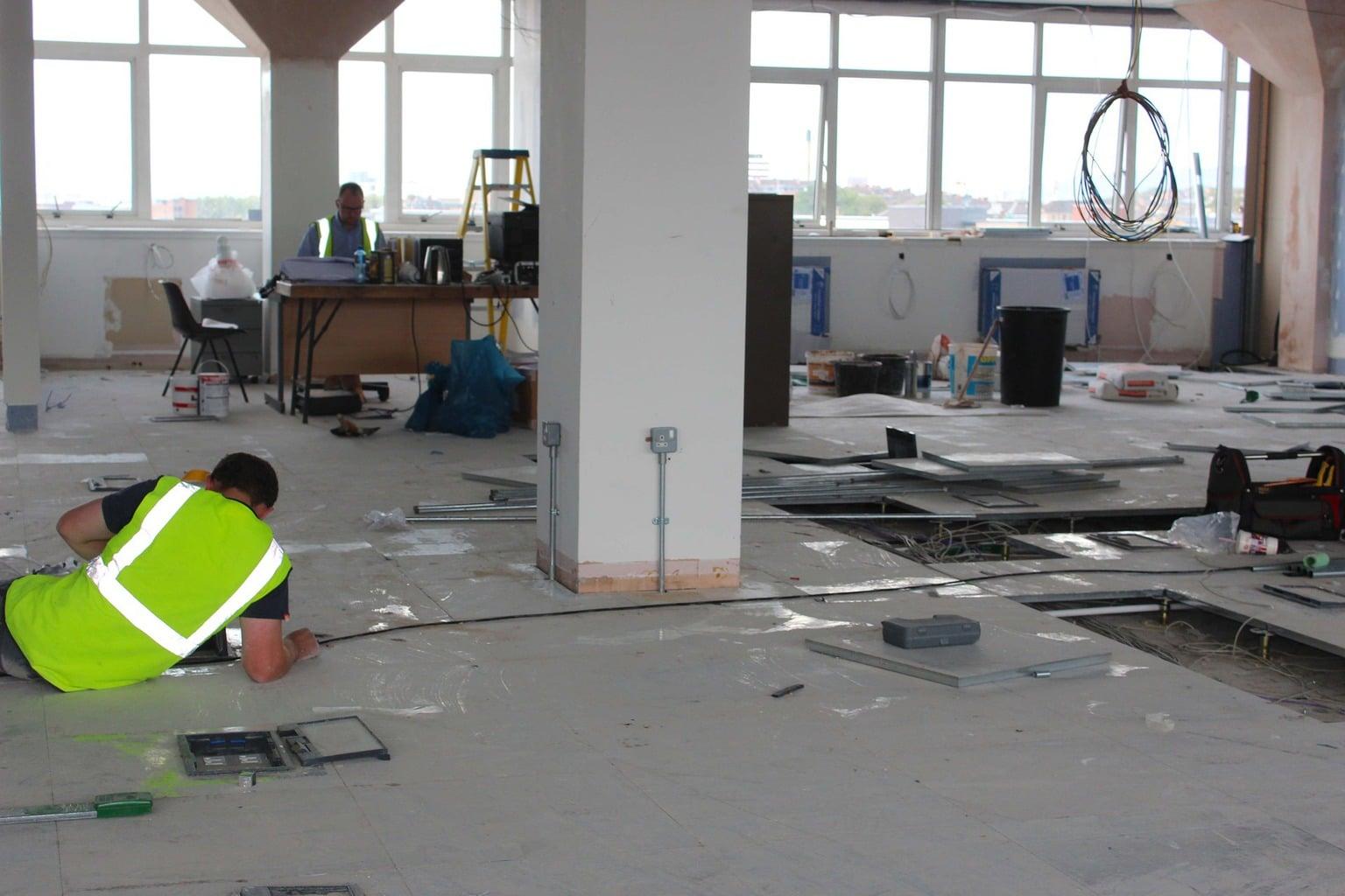 handymen working in office
