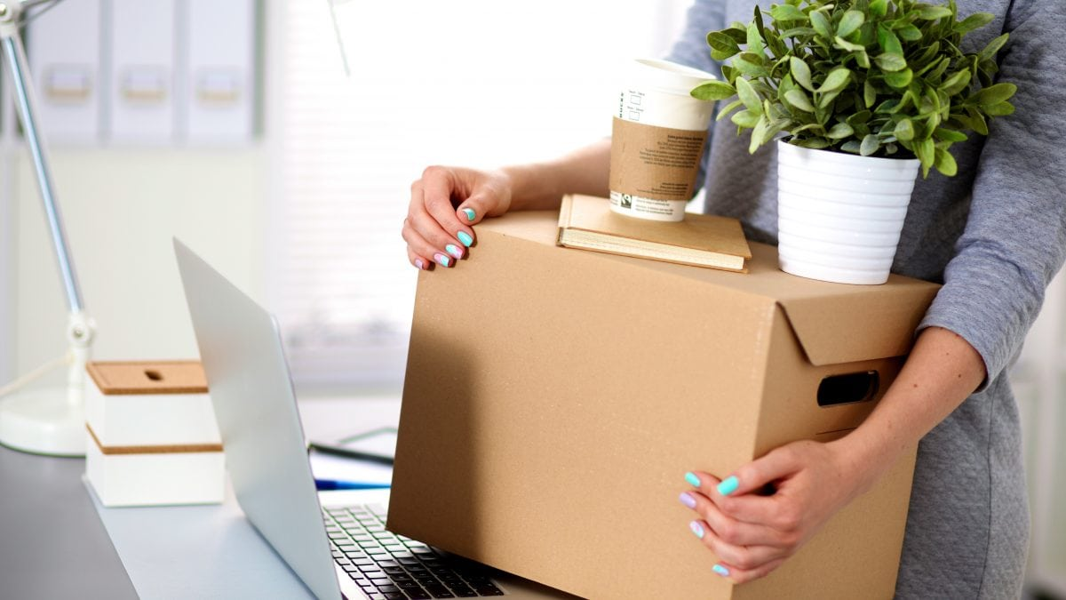 office worker packing a box