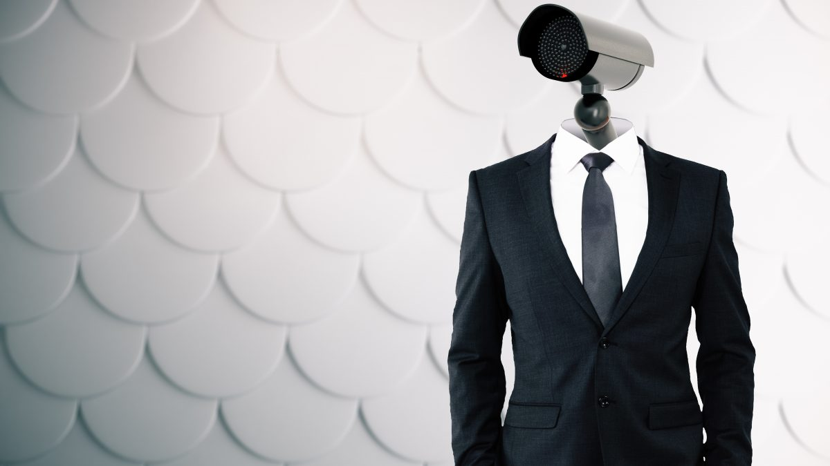 CCTV camera headed man on patterned grey background. Supervision concept