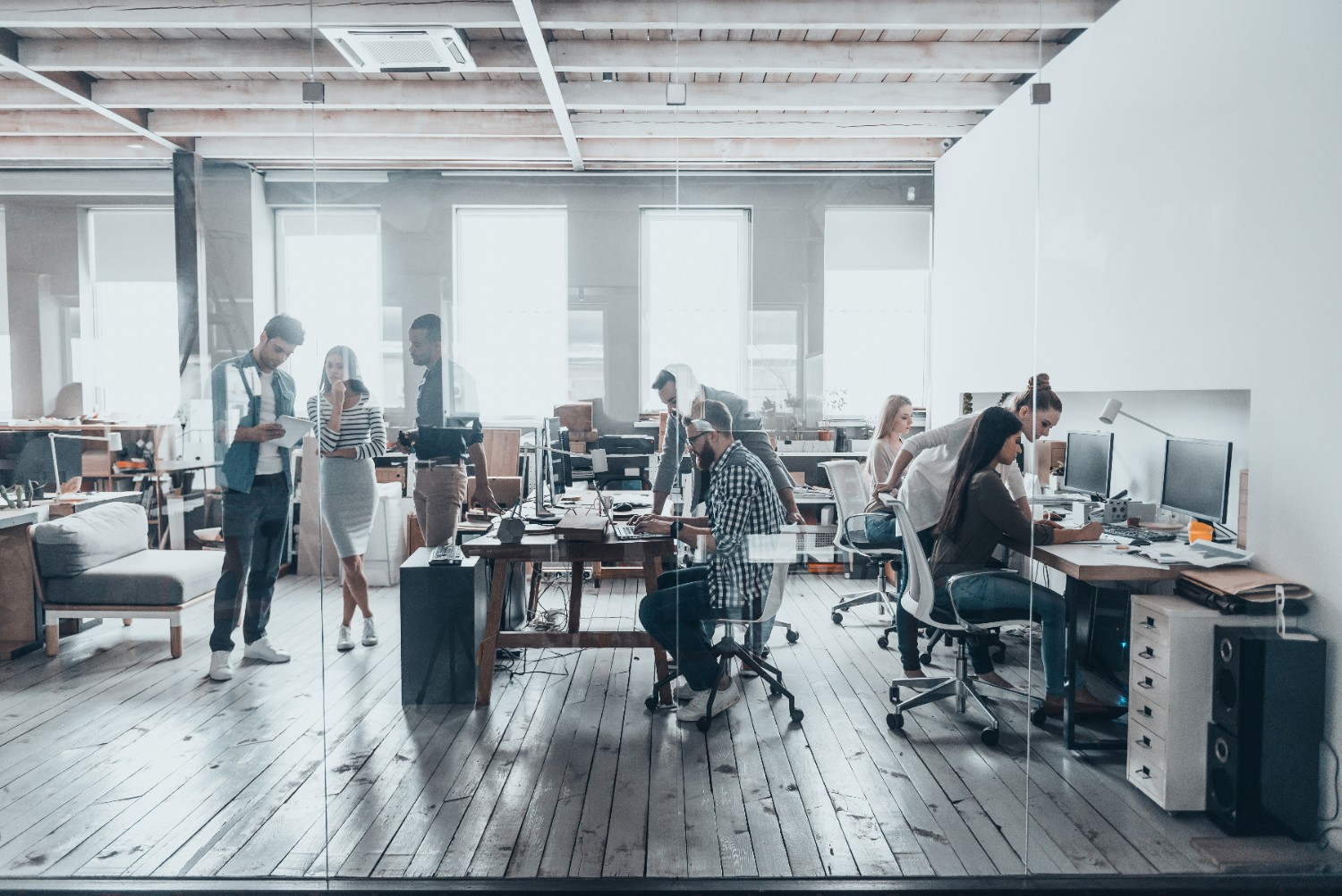 employees working in an office monitored by CCTV camera