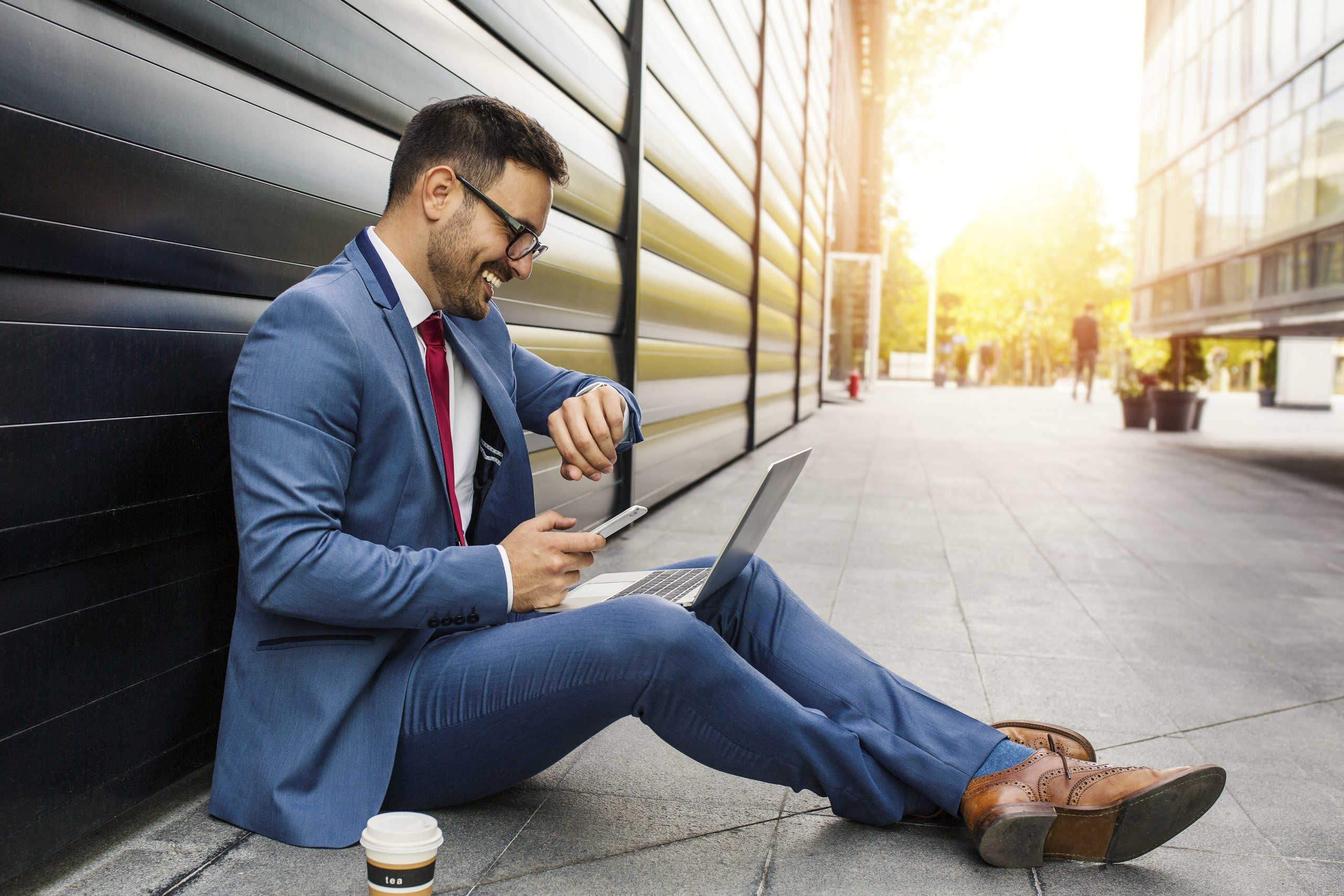 Man in suit working on laptop using business internet connection