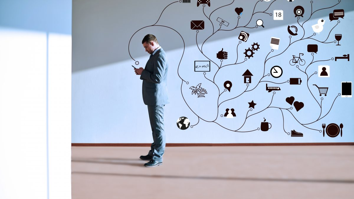 Businessman using various applications on smartphones that run on an internet connection