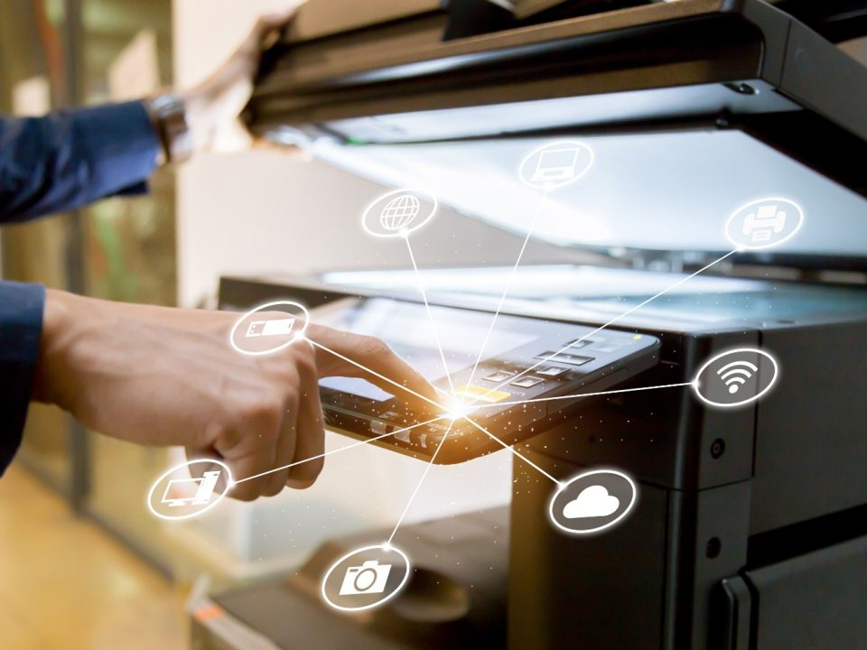 human hand pressing index finger on office printer touch interface
