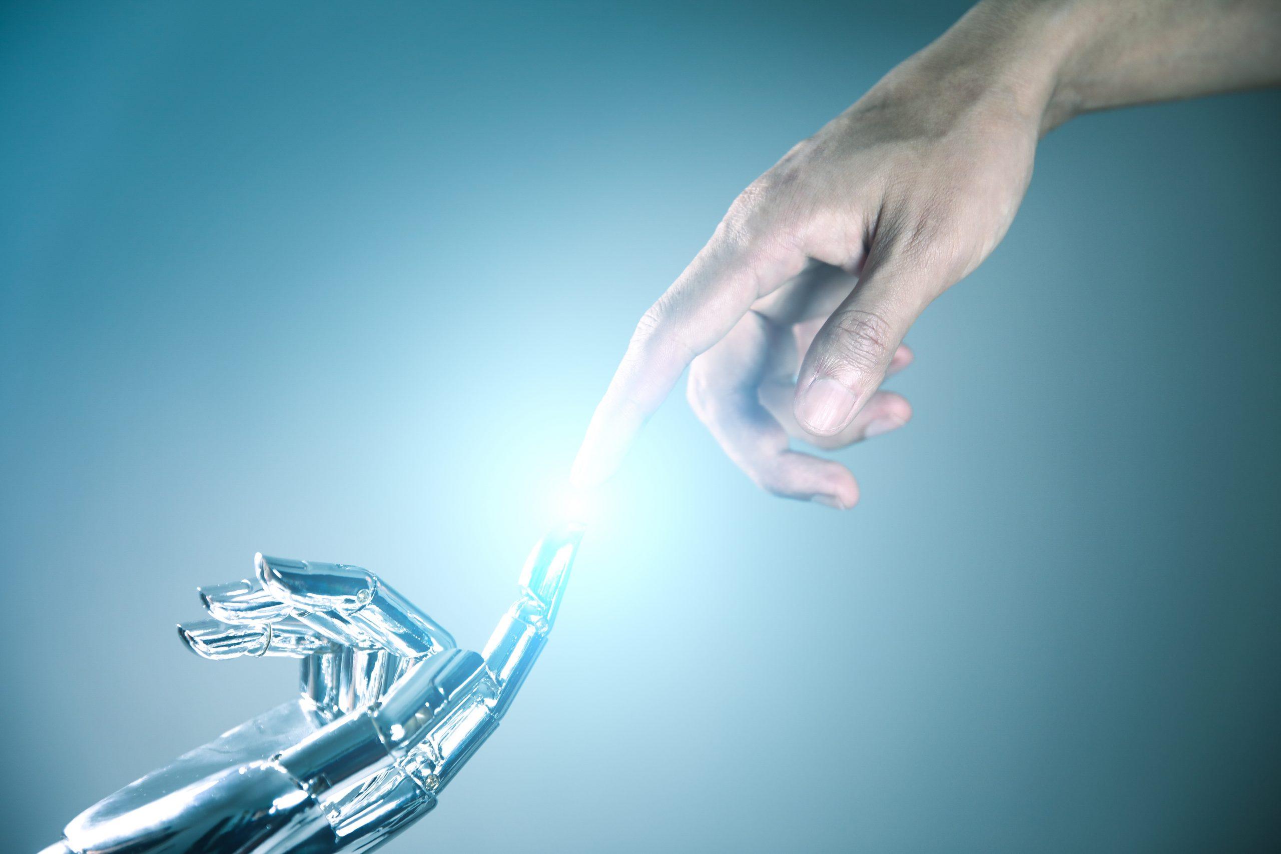 Human and robot hand connecting, indicating digital customer care