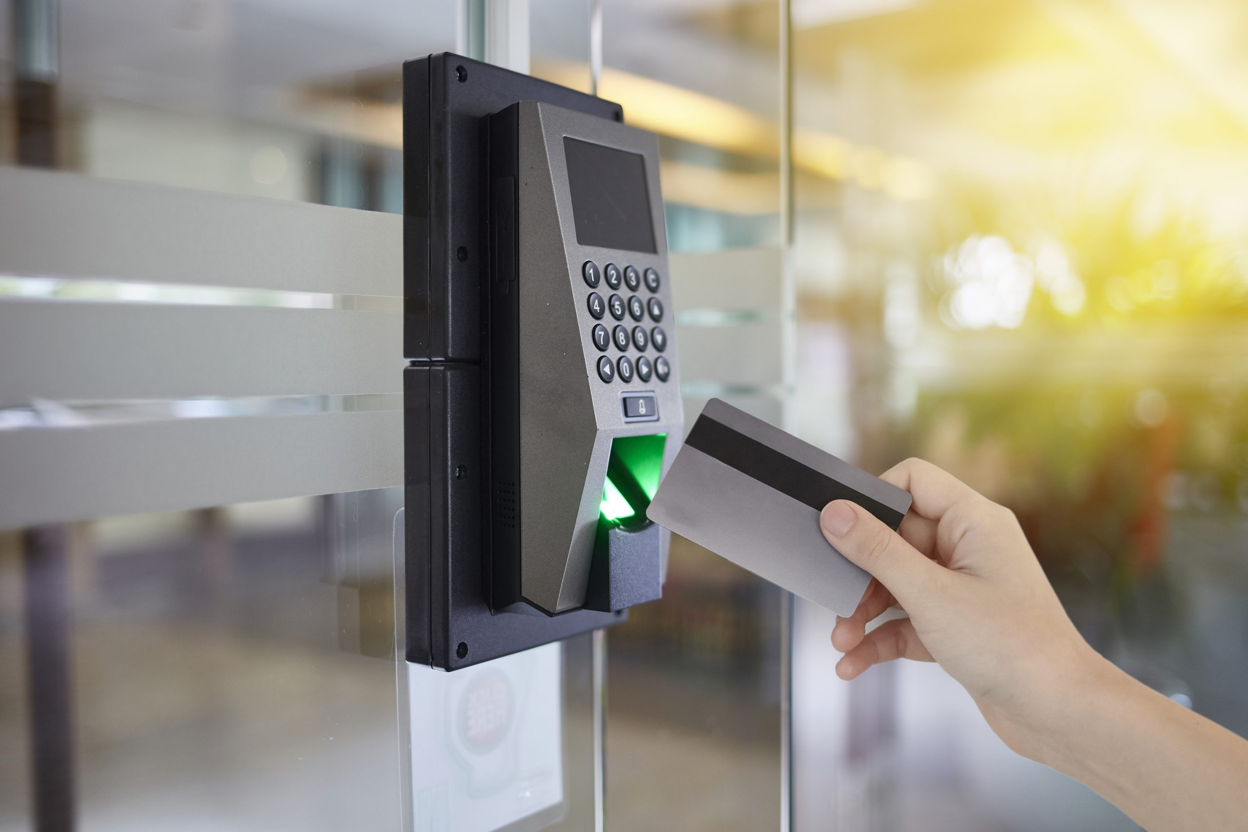 a person using a proximity card with CCTV