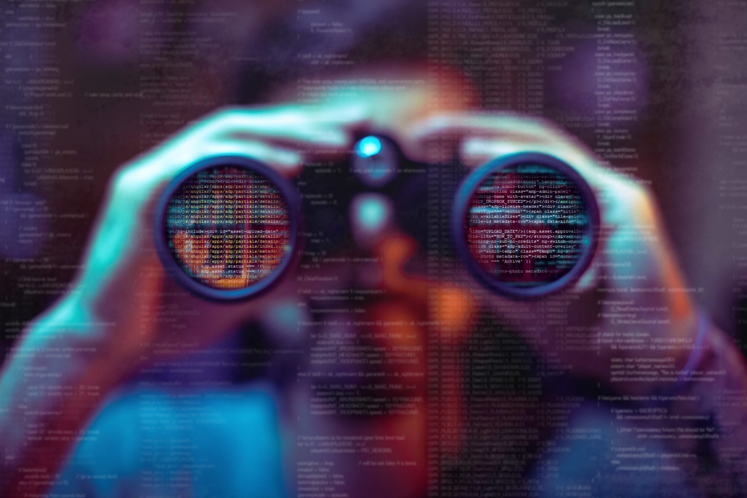 A man looking through binoculars, indicating remote CCTV surveillance