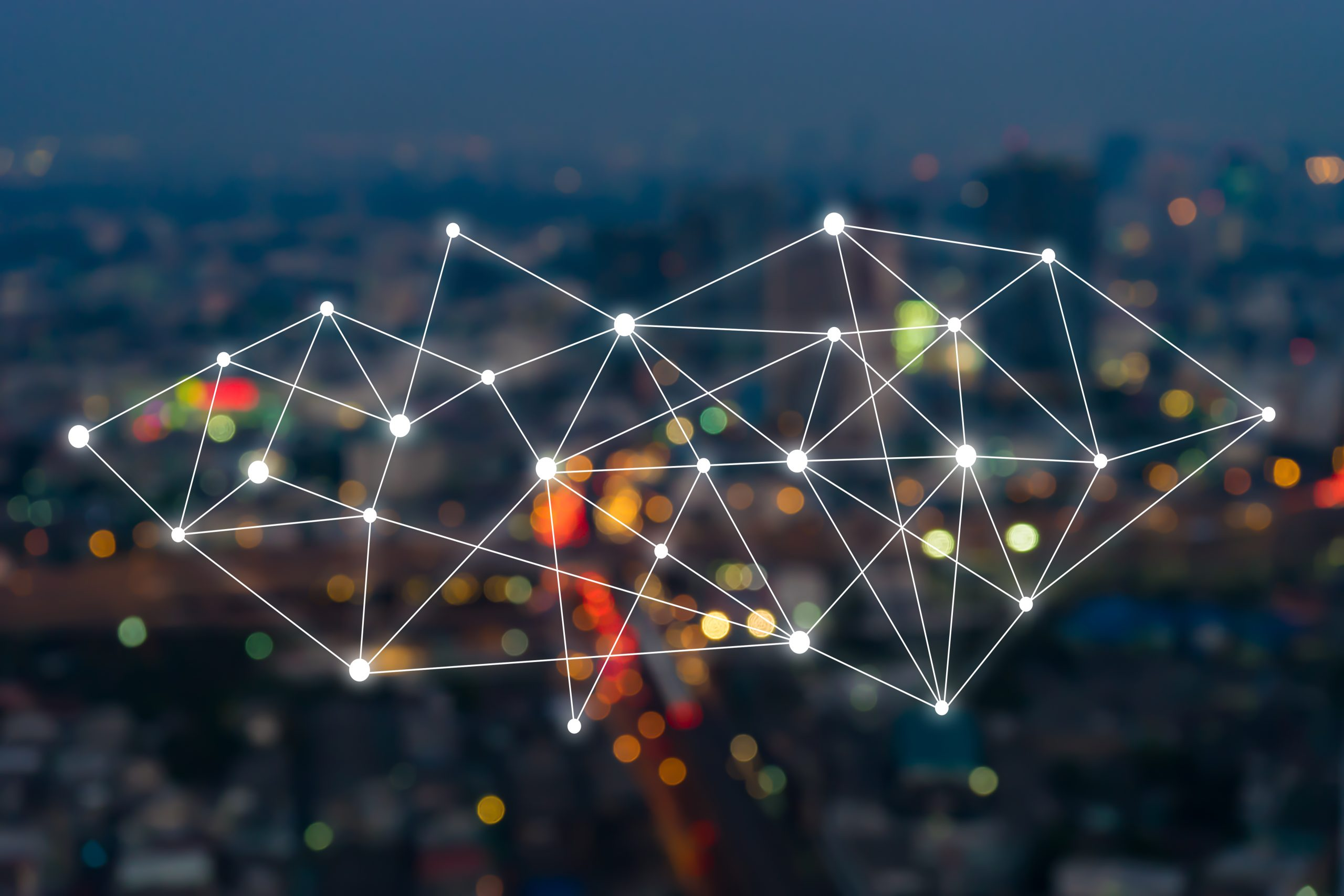 Big data connections. IOT - internet of things. Future technology digital concept on blurred abstract background of world map night city scape